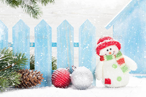 Christmas snowman and bauble toys and fir tree - Stock Photo - Images