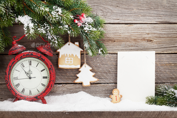 Christmas alarm clock and fir tree branch - Stock Photo - Images