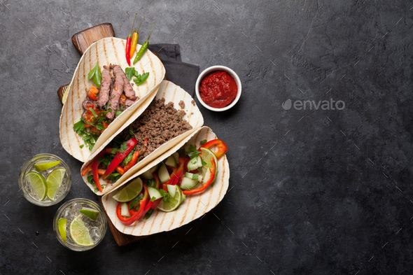 Mexican tacos and caipirinha cocktail - Stock Photo - Images