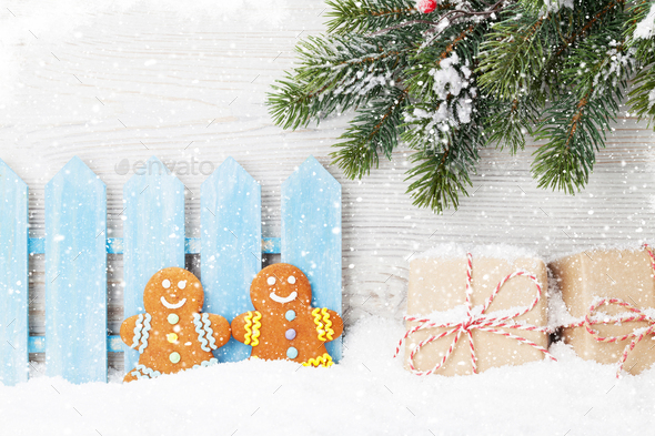 Christmas gift boxes, gingerbread cookies and fir tree - Stock Photo - Images