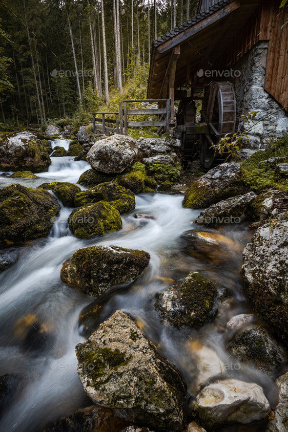 Creek Flowing by Ancient Wooden Mill near Gollinger Waterfall - Stock Photo - Images