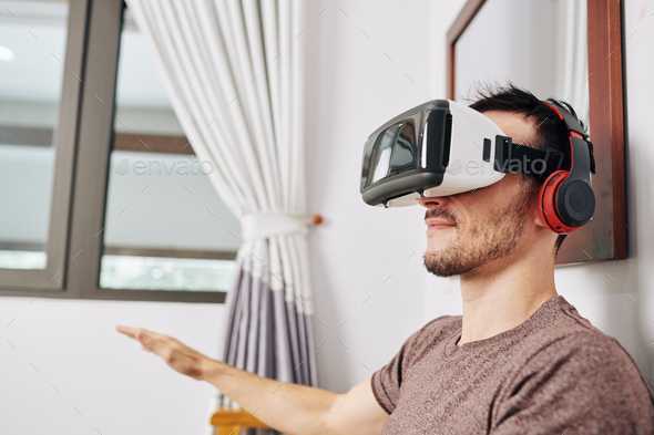 Young man in VR headset - Stock Photo - Images