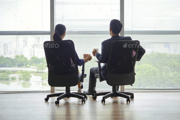Successful couple having coffee break - Stock Photo - Images