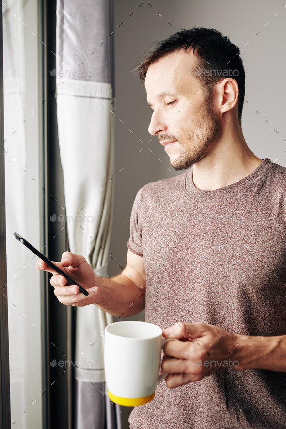 Man checking text messages - Stock Photo - Images
