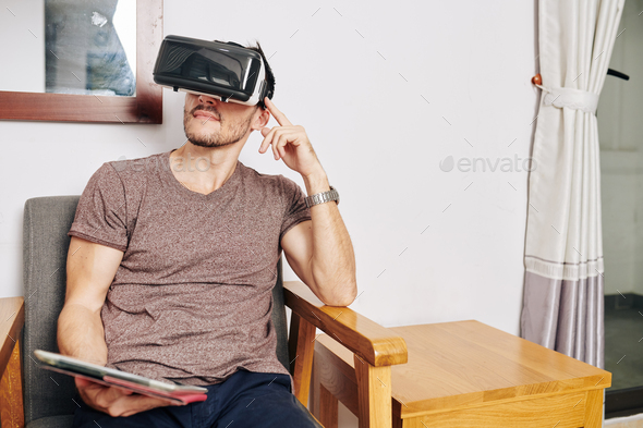 Man using VR headset - Stock Photo - Images