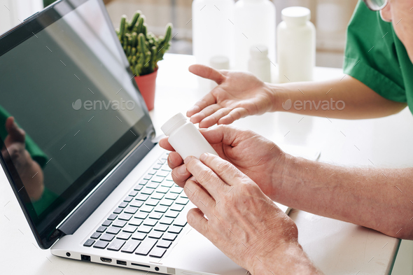 Doctor prescribing medicine to patient - Stock Photo - Images