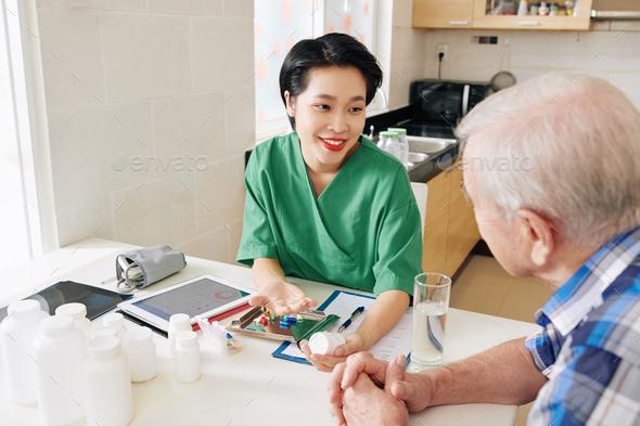 Medical nurse visiting senior patient - Stock Photo - Images