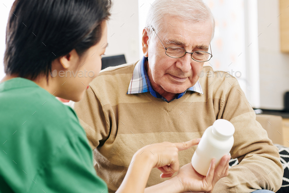 Nurse givining medicine to patient - Stock Photo - Images