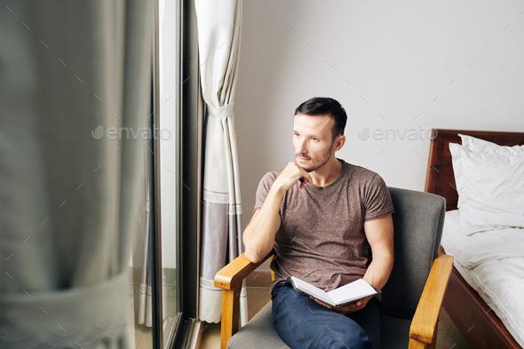 Man filling gratitude journal - Stock Photo - Images
