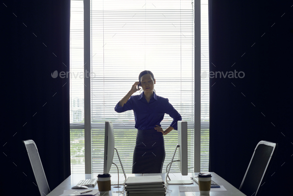 Confident businesswoman talking on phone - Stock Photo - Images