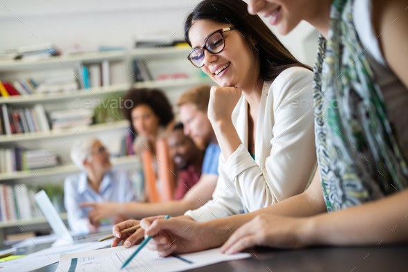 Cheerful coworkers in office during company meeting - Stock Photo - Images
