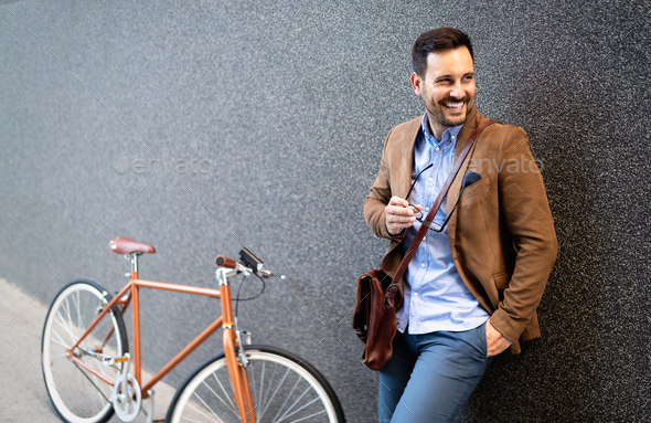 Young businessman riding on his bicycle. Going everywhere by his bike - Stock Photo - Images