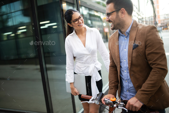 Office woman with business man couple enjoying break while talking flirting outdoor - Stock Photo - Images