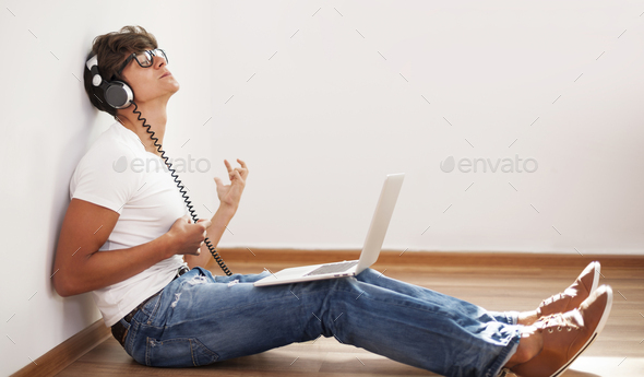 Hipster man playing air guitar - Stock Photo - Images