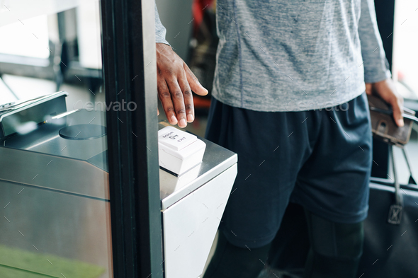Gym visitor pushing exit button - Stock Photo - Images