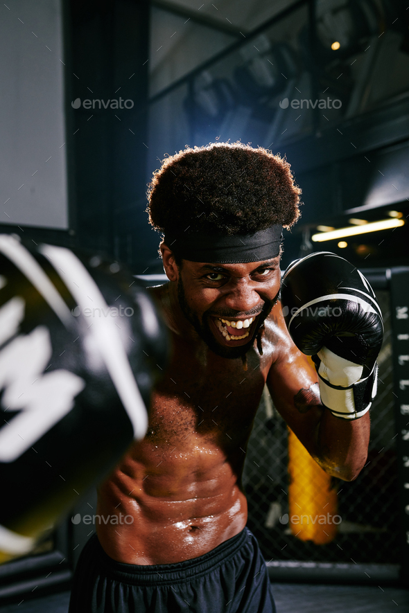 Excited shirtless Muay Thai boxer - Stock Photo - Images