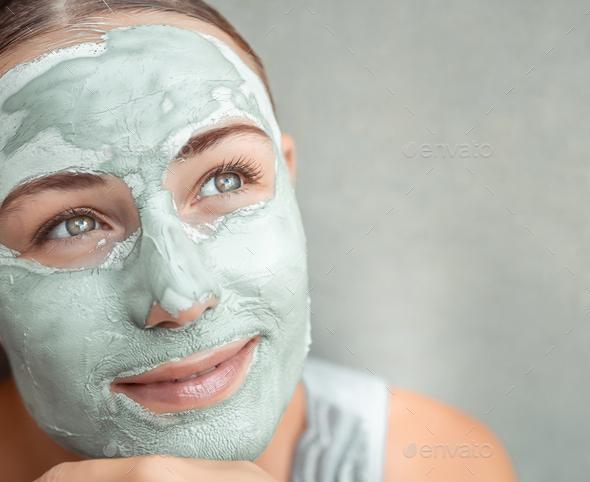 Beautiful girl doing facial mask - Stock Photo - Images