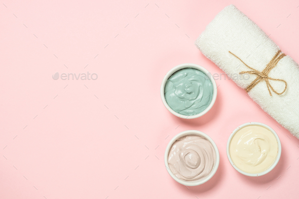 Clay mask on pink bakground, skincare product - Stock Photo - Images