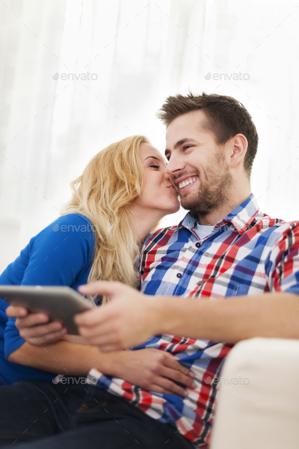 Portrait of lovely couple at home - Stock Photo - Images