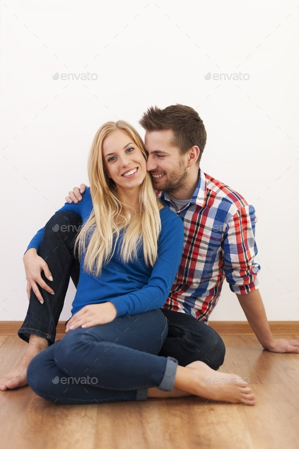 Happy couple flirting together at home - Stock Photo - Images