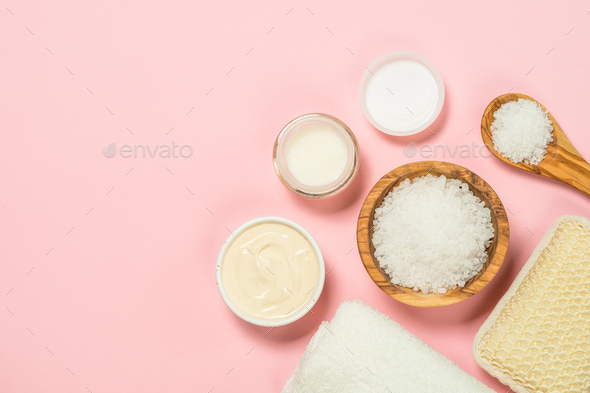 Spa flat lay background with sea salt and cosmetic oil on pink - Stock Photo - Images