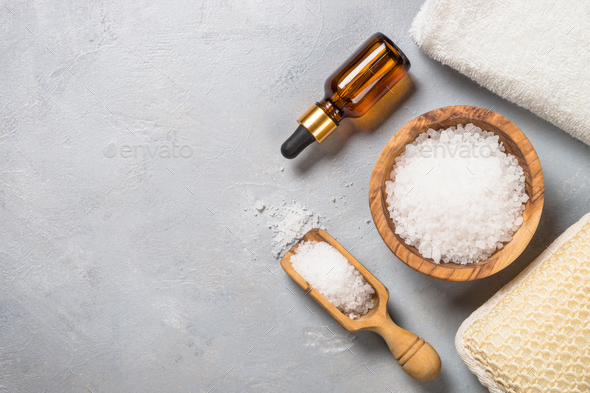 Sea salt and cosmetic oil on gray stone background - Stock Photo - Images