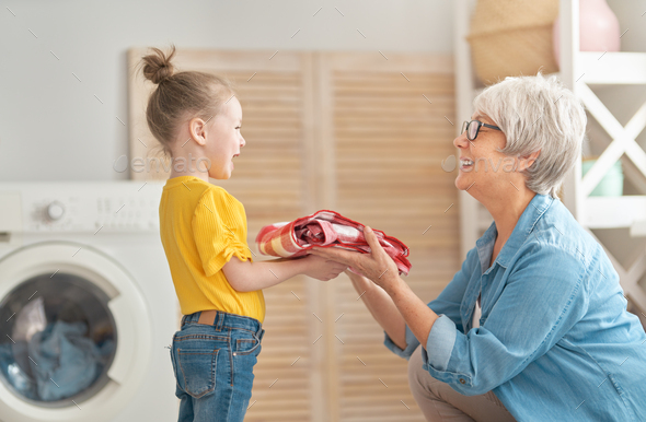 grandma and child are doing laundry - Stock Photo - Images