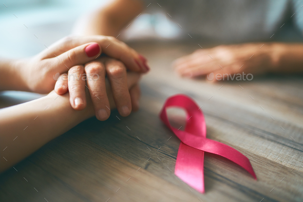 Females hands and symbol of Breast Cancer Awareness - Stock Photo - Images