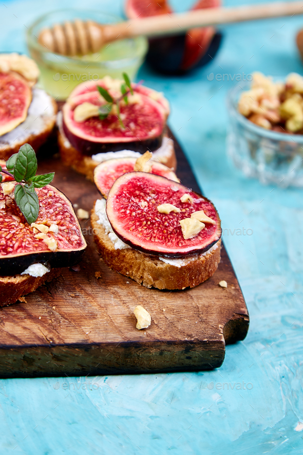 Bruschetta  or ctostini with cottage cheese, figs and honey. - Stock Photo - Images