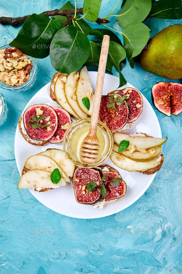 Bruschetta and Crostini with pear, ricotta cheese, honey, figs. - Stock Photo - Images