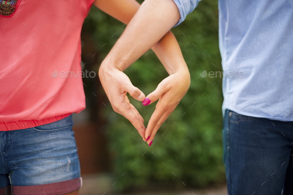 Heart shape made from hands - Stock Photo - Images