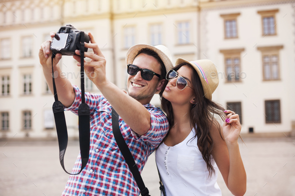 Happy tourists taking photo of themselves - Stock Photo - Images