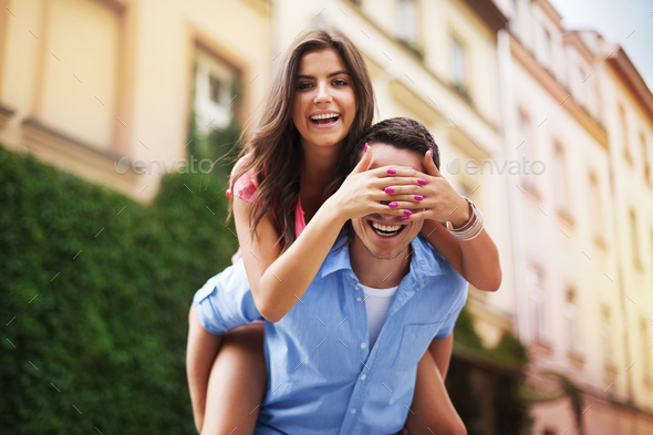 Beautiful woman spending funny time with her boyfriend - Stock Photo - Images