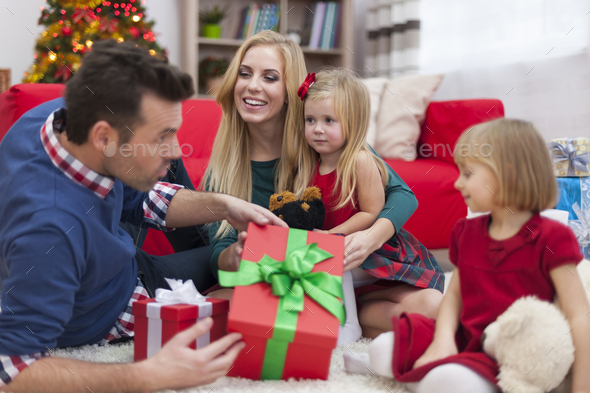 Happy time during the Christmas for young family - Stock Photo - Images