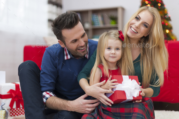 Special Christmas moments for young family - Stock Photo - Images