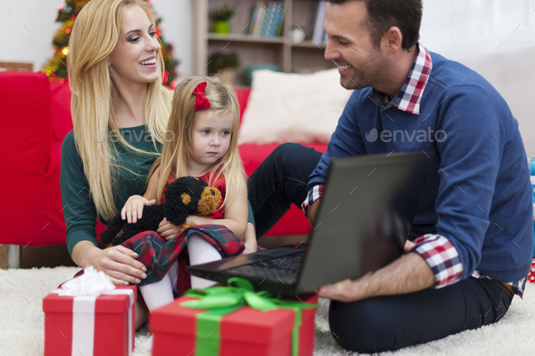 Happy time during Christmas for young family - Stock Photo - Images