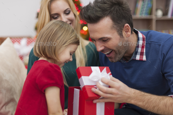 She always know what give us in Christmas - Stock Photo - Images