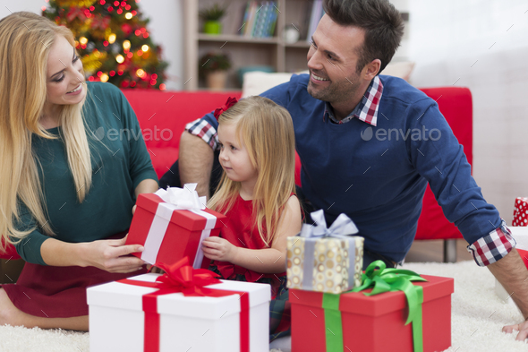 Young family enjoying the Christmas time - Stock Photo - Images