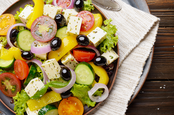 Top view at Mediterranean diet dish greek salad on vintage metal - Stock Photo - Images