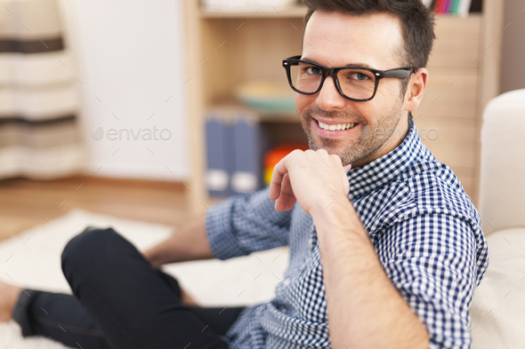 Portrait of smiling man at home - Stock Photo - Images