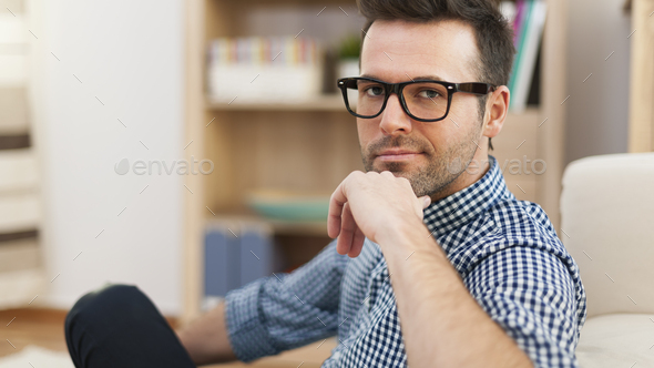 Portrait of handsome man wearing glasses - Stock Photo - Images