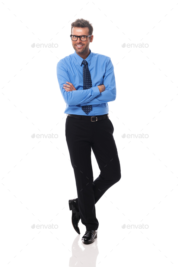 Portrait of smiling businessman wearing glasses looking at side - Stock Photo - Images
