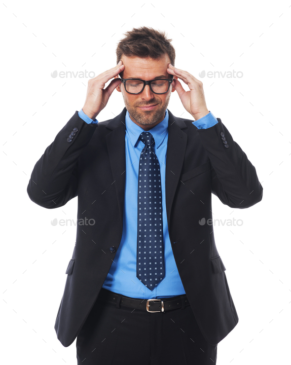 Businessman wearing glasses with awful headache - Stock Photo - Images
