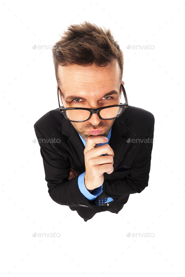 Angry businessman wearing fashion glasses grimacing - Stock Photo - Images