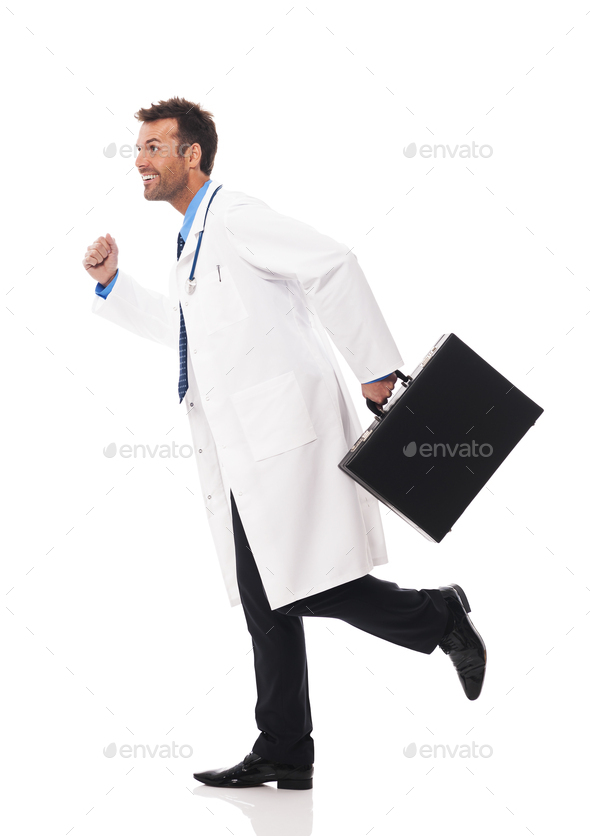 Doctor running urgency to patient - Stock Photo - Images
