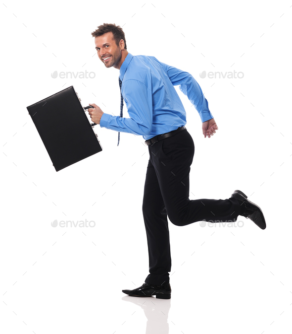 Happy businessman with briefcase running - Stock Photo - Images
