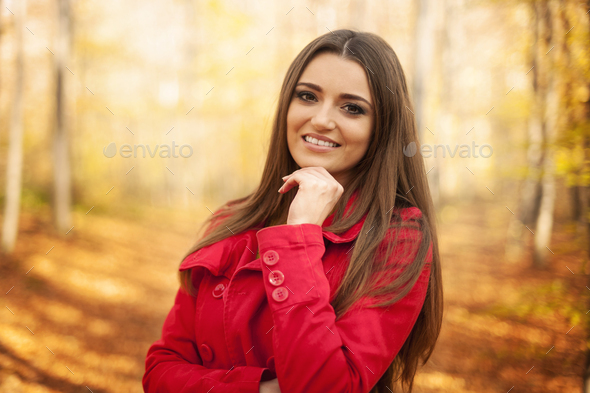 Portrait of beautiful woman in autumn time - Stock Photo - Images