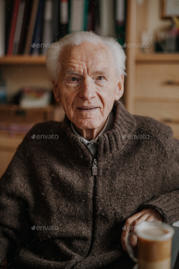Senior man sitting with cup of coffee - Stock Photo - Images