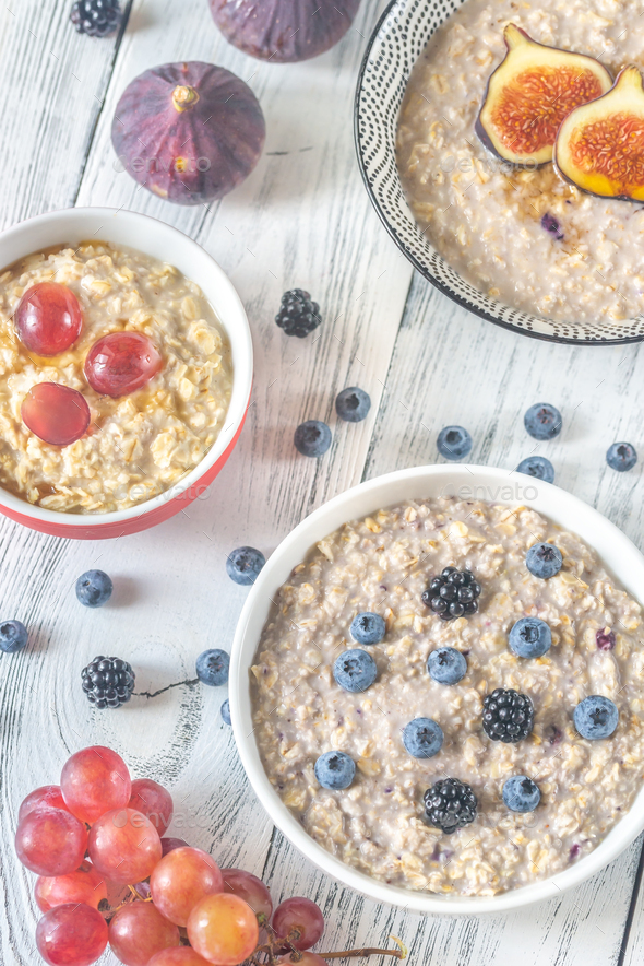 Three bowls of oatmeal - Stock Photo - Images