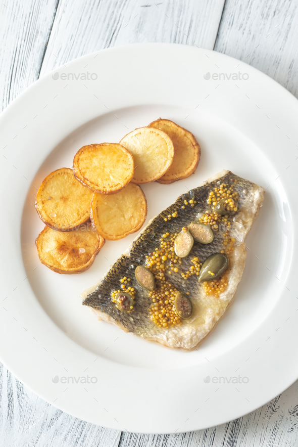 Baked sea bass with capers - Stock Photo - Images